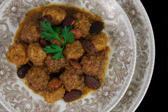 Meatballs with Almonds. Dish of meatball made with beef on almond sauce, presented in decorated porcelain plate royalty free stock images