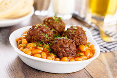 Meatballs and baked beans Royalty Free Stock Photography