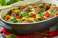 Meatballs baked in omelet. Royalty Free Stock Photography