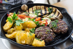 Meatballs with baked vegetables Stock Photo