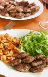 Meatballs with beef and spices, fries potatoes and Stock Photo