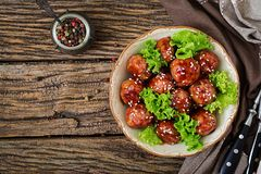 Meatballs with beef in sweet and sour sauce. Asian food. Top view. Flat lay Royalty Free Stock Photos
