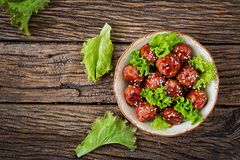 Meatballs with beef in sweet and sour sauce. royalty free stock image