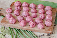 Meatballs. Of beef on a wooden Board with onion and pepper on the table Royalty Free Stock Image