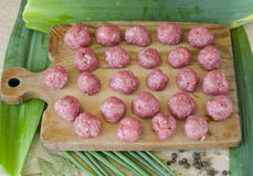 Meatballs. Of beef on a wooden Board with onion and pepper on the table Stock Image