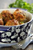 Meatballs in a blue pot on a wooden table. Stock Photos