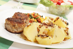 Meatballs with boiled potatoes Stock Photography