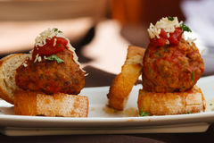 Meatballs on Bread. A close-up image of meatballs on toasted bread stock photo