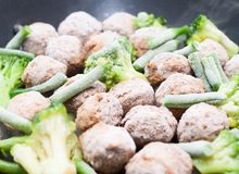Meatballs, broccoli and spinach stir-fried Royalty Free Stock Photo