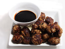 Meatballs and brown sauce dip Stock Photos