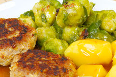 Meatballs, Brussels sprouts, potatoes Stock Images