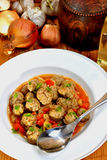 Meatballs with carrots in one pot Stock Photo