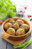 Meatballs in ceramic pan on wooden table royalty free stock photo