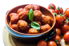 Meatballs in ceramic pot Stock Image