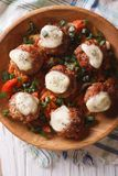 Meatballs with cheese in bowl closeup. vertical top view Royalty Free Stock Photography