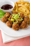 Meatballs with chips Royalty Free Stock Image