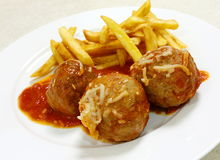 Meatballs and chips Royalty Free Stock Image
