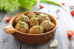 Meatballs and chive in ceramic pan stock photography