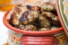 Meatballs in clay bowl Royalty Free Stock Image