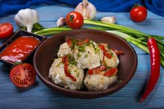 Meatballs in clay plate stock images
