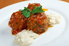 Meatballs cooked with vegetables stock images