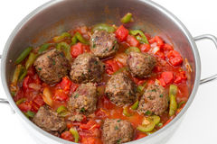 Meatballs cooking in a sauce Stock Photos