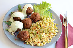 Meatballs with couscous and sauce Royalty Free Stock Image