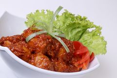 Meatballs covered in spicy sauce royalty free stock images