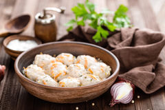 Meatballs. In cream sauce on wooden background stock image