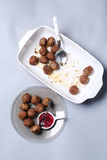 Meatballs for dinner. Many meatballs and some jam in a plate, Swedish dish stock images