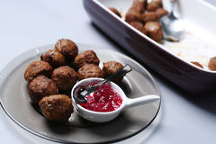 Meatballs for dinner. Many meatballs and some jam in a plate, Swedish dish royalty free stock photos