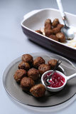 Meatballs for dinner. Many meatballs and some jam in a plate, Swedish dish stock image
