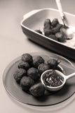Meatballs for dinner. Many meatballs and some jam in a plate, Swedish dish royalty free stock photo