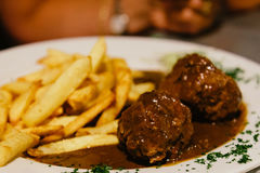 Meatballs with french fries in Brussels Stock Photo
