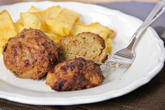 Meatballs with french fries Royalty Free Stock Photo
