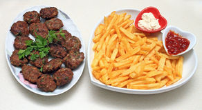 Meatballs and fries stock photos
