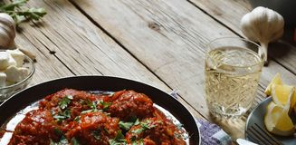 Meatballs in a frying pan cooked in tomato sauce. close up Stock Photos