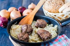 Meatballs stuffed with onion. Meatballs on frying pan stuffed with onion royalty free stock photo
