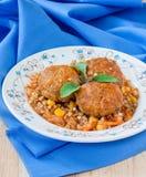 Meatballs garnished with green buckwheat Stock Photo