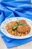 Meatballs garnished with green buckwheat Royalty Free Stock Photography