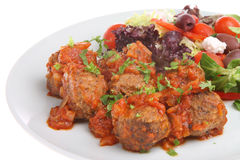 Meatballs with Greek Salad Stock Photography