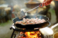 Meatballs on grill in the garden Stock Photography