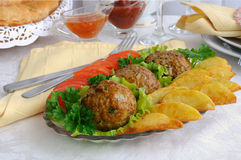 Meatballs with herbs and potatoes Royalty Free Stock Photo