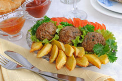 Meatballs with herbs and potatoes Stock Photo
