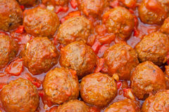 Meatballs. With homemade tomato sauce in pan. selective focus Stock Image