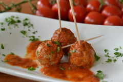 Meatballs in honey tomato sauce. Three meatballs in honey tomato sauce Stock Image