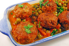 Meatballs In Sauce With Peas Stock Image