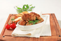Meatballs and kebabs. Meatballs in tomato sauce and minced meat kebabs Stock Image
