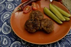 Meatballs with Ketchup. Some  meatballs with ketchup and cucumber Royalty Free Stock Images