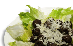 Meatballs letuce and chesse. In a dish Stock Photography